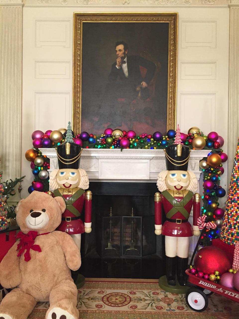 <p>Ever-serious Abraham Lincoln is flanked by two giant nutcrackers, a massive teddy bear, and trees made of candy. <i>(Photo: Cassie Carothers)</i></p>