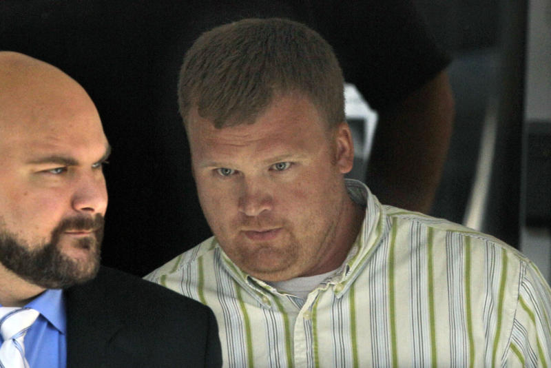 "In this June 20, 2012 file photo, Matt Sandusky, adopted son of Jerry Sandusky, right, leaves the Centre County Courthouse in Bellefonte, Pa. A Philadelphia attorney said Friday Aug. 23, 2013 seven young men he represents have finalized deals with Penn State over claims of abuse by the school's former assistant football coach, Jerry Sandusky. Lawyer Matt Casey said his clients include Sandusky's adopted son, Matt, as well as the young man known as ""Victim 2"" in court records and three other victims who testified last summer against Jerry Sandusky at his criminal trial. (AP Photo/Gene J. Puskar, File)"
