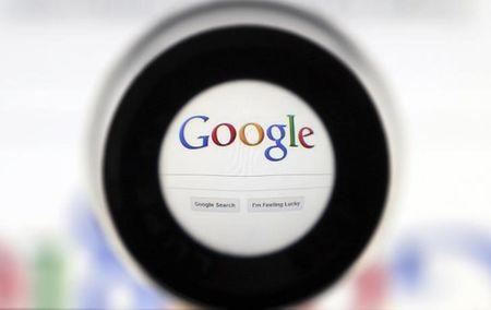 A Google search page is seen through a magnifying glass in this photo illustration taken in Brussels