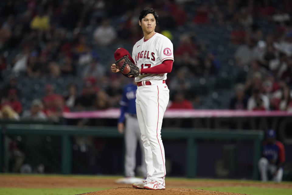 Los Angeles Angels starting pitcher Shohei Ohtani stands on the mound during the seventh inning of a baseball game against the Texas Rangers Friday, Sep. 3, 2021, in Anaheim, Calif. (AP Photo/Ashley Landis)