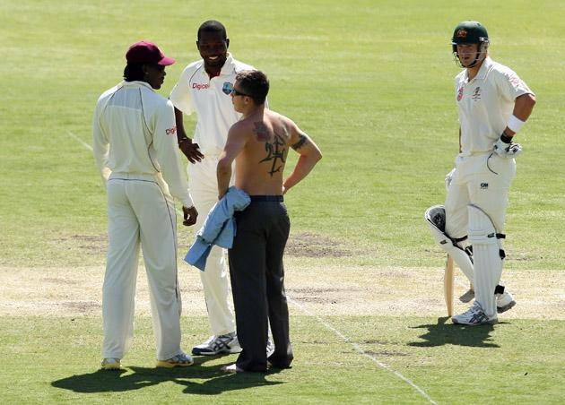 ADELAIDE, AUSTRALIA - DECEMBER 05:  A pitch invader stops and speaks to Chris Gayle and Sulieman Benn of the West Indies as Shane Watson of Australia watches on during day two of the Second Test match between Australia and the West Indies at Adelaide Oval on December 5, 2009 in Adelaide, Australia.  (Photo by Mark Kolbe/Getty Images) *** Local Caption *** Shane Watson;Chris Gayle;Sulieman Benn