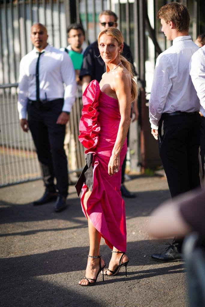 Celine Dion wears a pink ruffled dress, a necklace, earrings, outside Miu Miu Club 2020, on June 29, 2019 in Paris, France. [Photo: Getty]
