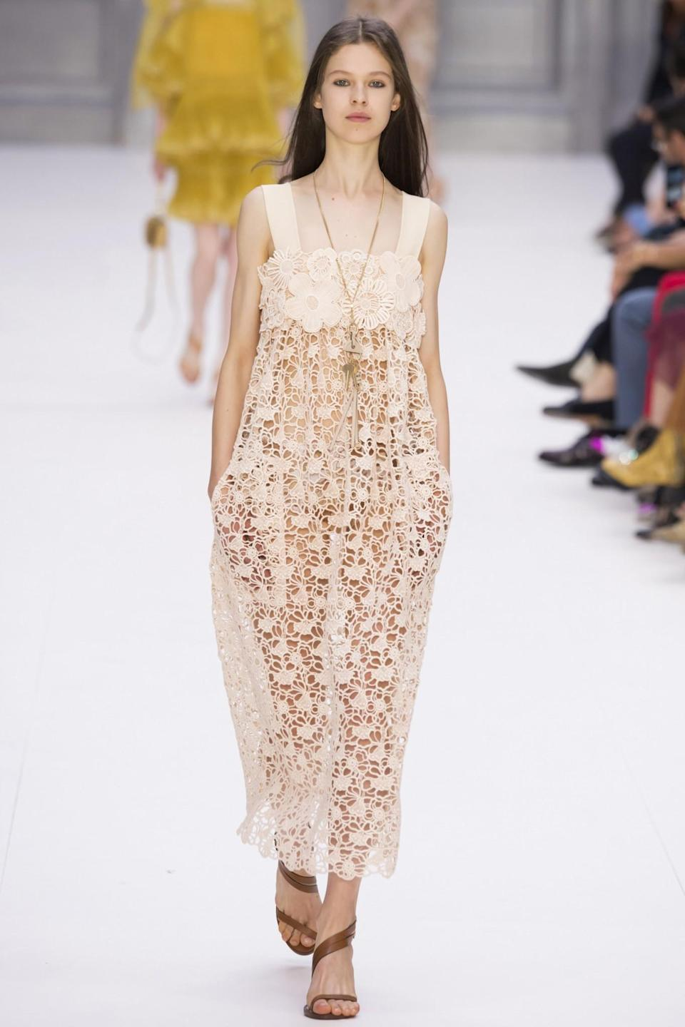 <p>A model in a classic Chloé silhouette and style — a 1970s inspired, loosely fitted, delicate lace dress that's effortlessly cool and ultrafeminine. (Photo: Getty Images) </p>