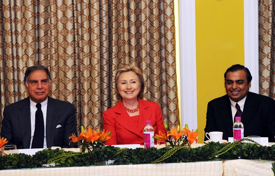 In this handout picture provided by the US State Department, US Secretary of State Hillary Rodham Clinton (C) meets with Tata Group Chairman Ratan Tata (L) and Reliance Industries Chairman and Managing Director Mukesh Ambani along with other prominent Indian business leaders at the Taj Mahal Palace Hotel in Mumbai on July 18, 2009. Clinton arrived in India hoping to deepen strategic ties with an emerging player on the world stage in security, trade, arms control and climate change. Her first stop in the country's financial and entertainment capital Mumbai, includes meetings with key business leaders, educational professionals and a women's group, as well as leading Bollywood actor Aamir Khan. In her maiden trip to the South Asian nation as Washington's chief diplomat, Clinton will also pay tribute to the 166 people who died in last year's Islamist militant attacks on the city. AFP PHOTO/HO