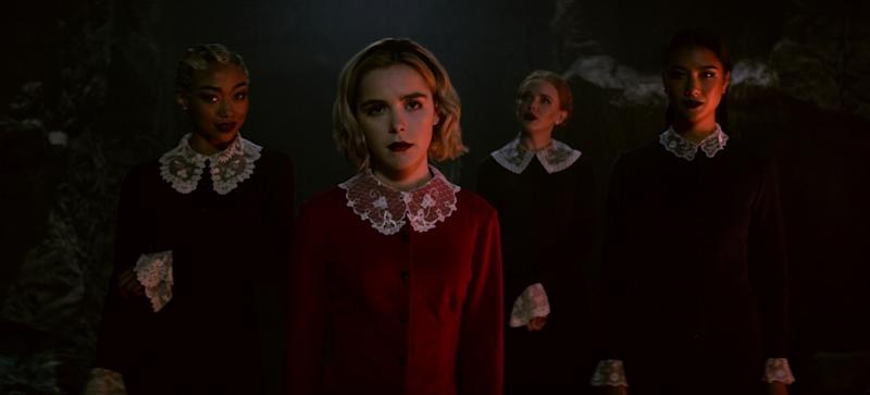 Tati Gabrielle, Kiernan Shipka, Abigail Cowen, and Adeline Rudolph in a scene from Netflix original series The Chilling Adventures of Sabrina.