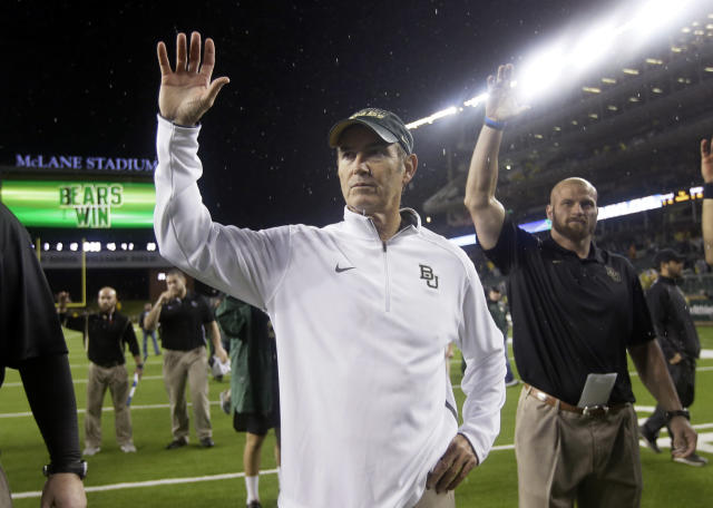 Baylor head coach Art Briles gestures the Sic'em bear claw with members of his staff after their 49-28 win over Oklahoma State in an NCAA college football game, Saturday, Nov. 22, 2014, in Waco, Texas. (AP Photo/Tony Gutierrez)