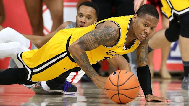 Jairus Lyles sent UMBC to the NCAA tournament with a last-second 3-pointer against Vermont. (AP)