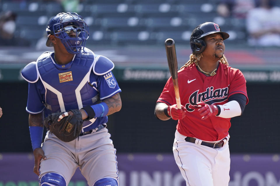 Cleveland Indians' Jose Ramirez, right, watches his ball along with Kansas City Royals catcher Salvador Perez after Ramirez hit a two-run home run in the eighth inning of a baseball game, Wednesday, April 7, 2021, in Cleveland. The Indians won 4-2. (AP Photo/Tony Dejak)