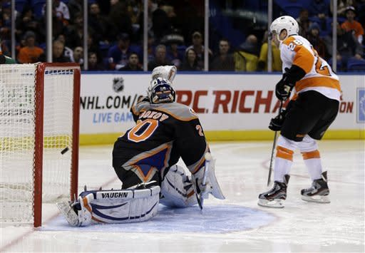 Philadelphia Flyers' Claude Giroux, right, scores past New York Islanders goalie Evgeni Nabokov during the first period of the NHL hockey game Monday, Feb. 18, 2013, in Uniondale, N.Y. (AP Photo/Seth Wenig)