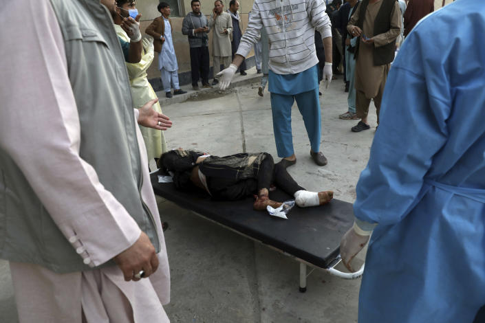 An injured school student is transported to a hospital after a bomb explosion near a school in west of Kabul, Afghanistan, Saturday, May 8, 2021. A bomb exploded near a school in west Kabul on Saturday, killing several, many them young students, Afghan government spokesmen said. (AP Photo/Rahmat Gul)