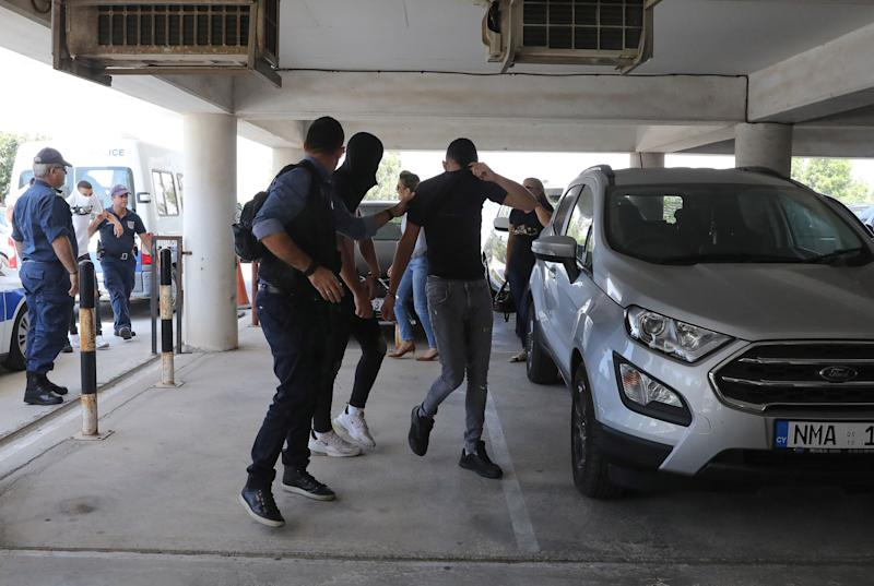 Twelve Israeli tourists, pictured arriving at a Cypriot court, were cleared of raping the girl. (Getty)