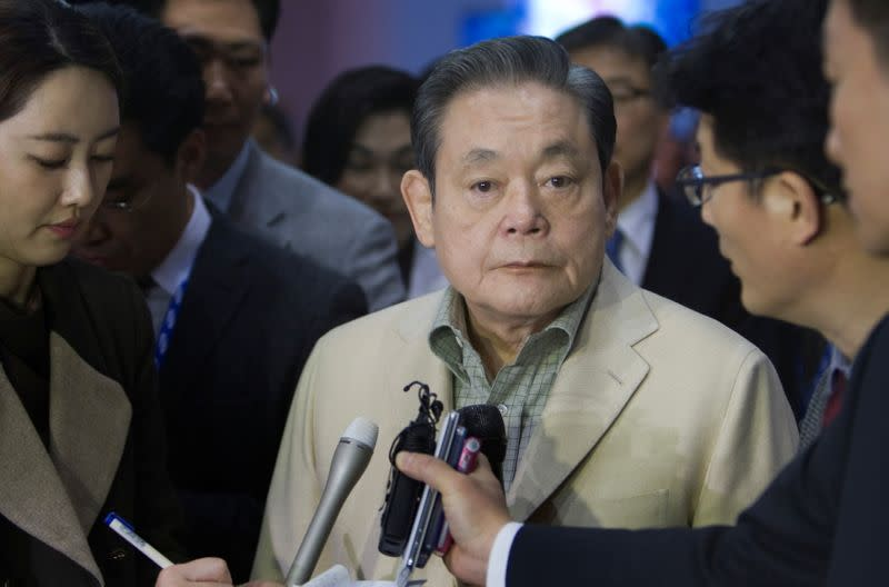 FILE PHOTO: Samsung Electronics Chairman Lee listens to a question from a reporter after touring the Samsung booth at the CES in Las Vegas