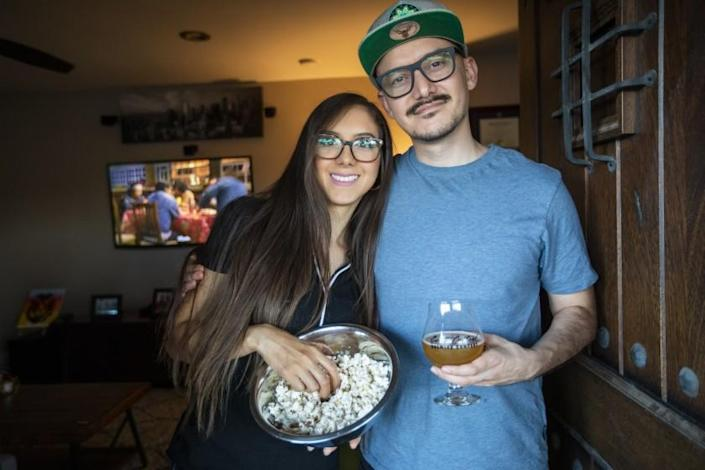 NORWALK, CA - MAY 28: Portrait of Esmeralda Garza, 25, and Salvador Limon, 34, right, at home on Friday, May 28, 2021 in Norwalk, CA. Almost every Friday night as they have through most of the pandemic. cook dinner and settle in for a film. Like tens of millions of people every night across the United States. Lately, Esmeralda has wanted to watch films on an upstart streaming service called Pantaya, which specializes in Spanish-language middle-of-the-road genre fare the kind Esmeralda is more used to, since she's still learning English. (Francine Orr / Los Angeles Times)