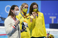 From left, Siobhan Bernadette Haughey, of Hong Kong, Emma Mckeon, of Australia and Cate Campbell, of Australia pose with their medals after the women's 100-meter freestyle final at the 2020 Summer Olympics, Friday, July 30, 2021, in Tokyo, Japan. (AP Photo/Jae C. Hong)