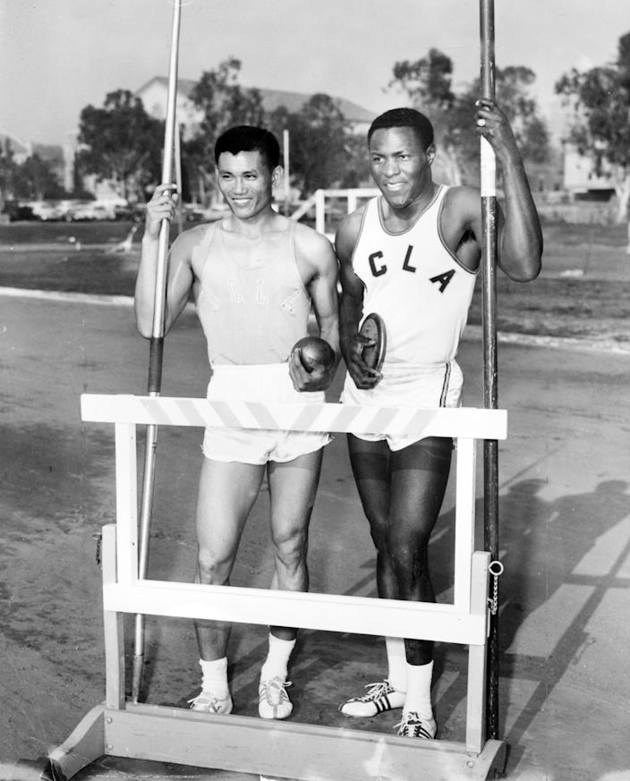 Rafer Johnson, right, with UCLA freshman C.K. Kang at track practice in 1960.