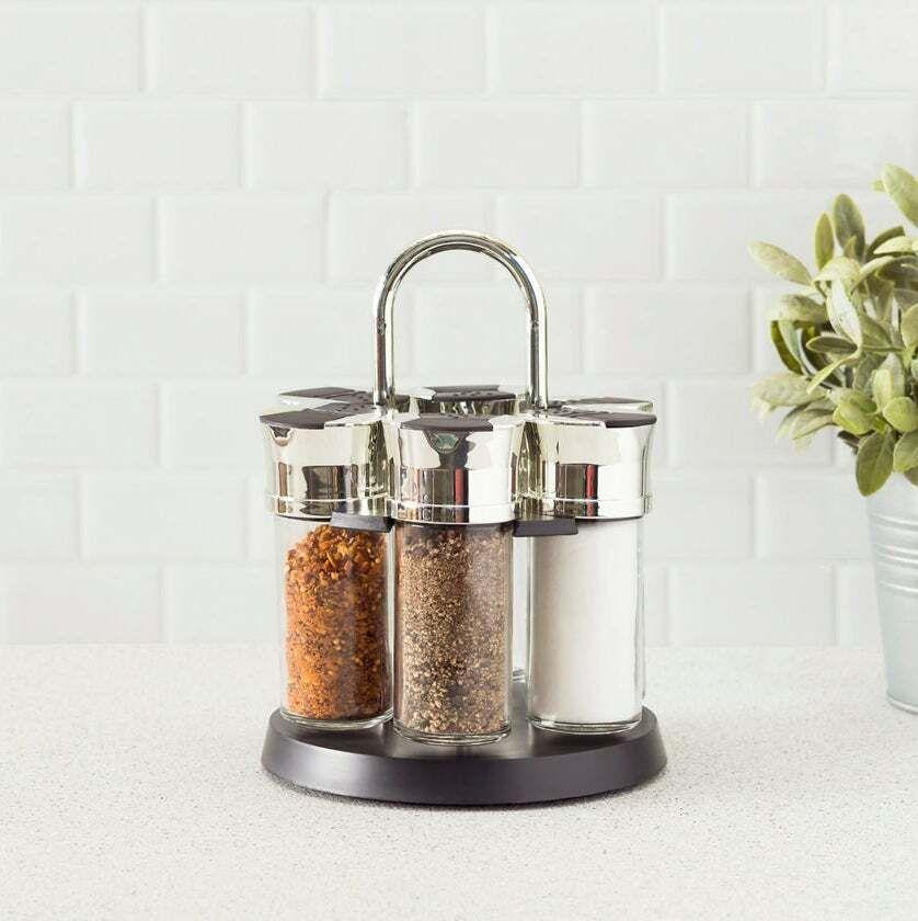 """Put the spicesyou reach for the most in it, and you'll be able to grab them in seconds. Plus, this is way more elegant than simply sitting them on top of the stove.<br /><br /><strong>Get it from Ashley Homestore for<a href=""""https://go.skimresources.com?id=38395X987171&xs=1&url=https%3A%2F%2Fwww.ashleyfurniture.com%2Fp%2Fhome_accents_compact_carousel_6-jar_spice_rack_with_steel_carrying_handle_black%2FK600001242.html&xcust=HPKitchenTime60902778e4b09cce6c214b8f"""" target=""""_blank"""" rel=""""nofollow noopener noreferrer"""" data-skimlinks-tracking=""""5833640"""" data-vars-affiliate=""""Rakuten"""" data-vars-campaign=""""SHOPKitchenAllTimeBoanYang1-11-20--5833640-"""" data-vars-href=""""https://click.linksynergy.com/deeplink?id=yPKHhJU2qBg&mid=40094&murl=https%3A%2F%2Fwww.ashleyfurniture.com%2Fp%2Fhome_accents_compact_carousel_6-jar_spice_rack_with_steel_carrying_handle_black%2FK600001242.html&u1=SHOPKitchenAllTimeBoanYang1-11-20--5833640-"""" data-vars-link-id=""""16406282"""" data-vars-price="""""""" data-vars-product-id=""""20983144"""" data-vars-product-img=""""https://ashleyfurniture.scene7.com/is/image/AshleyFurniture/K600001242_1?$AFHS-PDP-Main$"""" data-vars-product-title=""""Home Accents Compact Carousel 6-Jar Spice Rack with Steel Carrying Handle, Black"""" data-vars-redirecturl=""""https://www.ashleyfurniture.com/p/home_accents_compact_carousel_6-jar_spice_rack_with_steel_carrying_handle_black/K600001242.html"""" data-vars-retailers=""""ashleyfurniture"""" data-ml-dynamic=""""true"""" data-ml-dynamic-type=""""sl"""" data-orig-url=""""https://click.linksynergy.com/deeplink?id=yPKHhJU2qBg&mid=40094&murl=https%3A%2F%2Fwww.ashleyfurniture.com%2Fp%2Fhome_accents_compact_carousel_6-jar_spice_rack_with_steel_carrying_handle_black%2FK600001242.html&u1=SHOPKitchenAllTimeBoanYang1-11-20--5833640-"""" data-ml-id=""""1"""">$29.99</a>(originally $79.99).</strong>"""