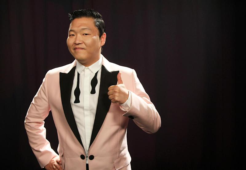 "This Aug. 22, 2012 photo shows South Korean rapper PSY, born Jae-Sang Park, posing for a photo in New York. The music video for ""Gangnam Style,"" released last month, so far has garnered more than 49 million views on YouTube. The bright, vibrant clip features the comedic and flamboyant PSY delivering somewhat bizarre choreography while rapping and singing in Korean over a thumping, dance-flavored beat. It's currently No. 1 on iTunes' music videos chart. (AP Photo/John Carucci)"