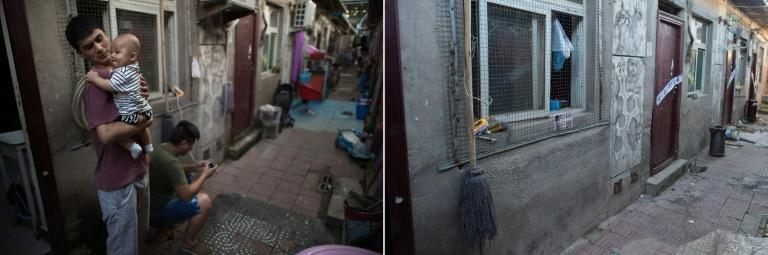 A mop still hangs from a window next to where a man held his baby in his arms months ago