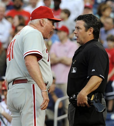 Philadelphia Phillies manager Charlie Manuel argues with home plate umpire Rob Drake after he was ejected for questioning a walk to Washington Nationals' Bryce Harper during the first inning of their baseball game at Nationals Park, Friday, May 4, 2012, in Washington. (AP Photo/Richard Lipski)