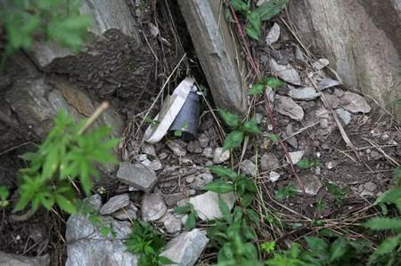 Part of an unexploded cluster bomb is seen near a residential area in village Jabri, in Neelum Valley