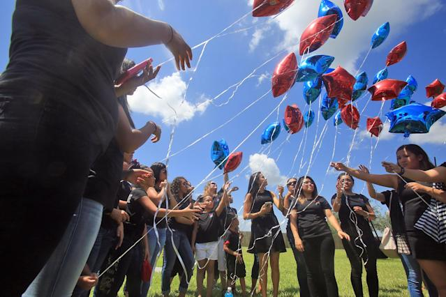 <p>Balloons are released as friends and family attend the burial of Frank Hernandez at Highland Memorial Park in Weslaco, Texas, June 18, 2016. (Joel Martinez/The Monitor via AP) </p>