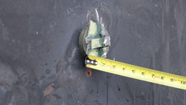 PHOTO: This photo depicts the aluminum and green composite material left behind following removal of an unexploded limpet mine used in an attack on the starboard side of motor vessel M/T Kokuka Courageous, while operating in the Gulf of Oman, June 13th. (DoD)