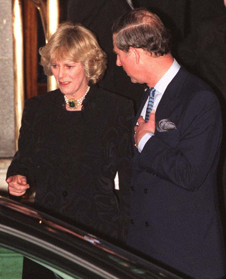 Camilla Parker Bowles and Prince Charles walk out of the Ritz January 28, 1999. More than 100 photographers took up positions outside London's Ritz hotel for the most elusive shot of all -- Prince Charles together with his long-time lover Camilla Parker Bowles. (photo by UK Press)