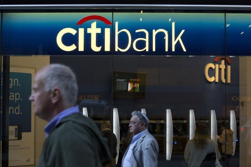 People walk past a Citibank branch in New York October 15, 2013.