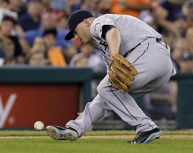 Seattle Mariners third baseman Kyle Seager slips while trying to field a ground ball hit by Detroit Tigers' Eugenio Suarez during the sixth inning of a baseball game Saturday, Aug. 16, 2014, in Detroit. Suarez was credited with a single on the play. (AP Photo/Duane Burleson)