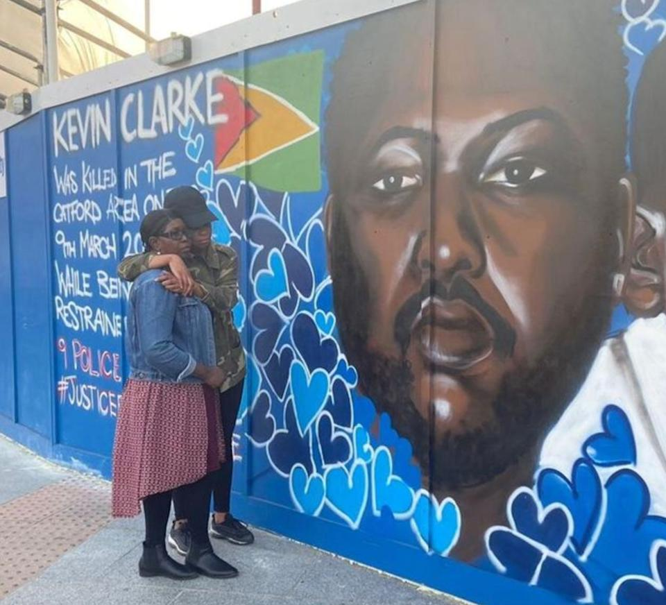 Wendy Clarke, Kevin's mother, and his sister Tellecia at a mural of Kevin Clarke in Lewisham  (Photo: PA )