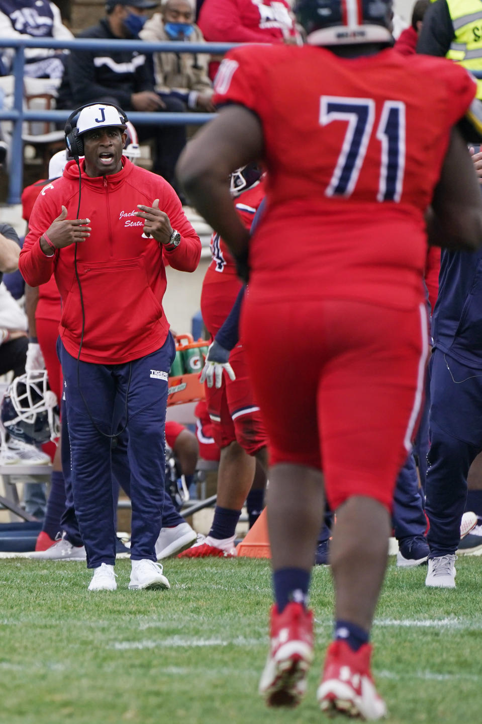 Jackson State head coach Deion Sanders calls out to his offense during the second half of an NCAA college football game against Edward Waters in Jackson, Miss., Sunday, Feb. 21, 2021. The game marked the coaching debut of Sanders. (AP Photo/Rogelio V. Solis)