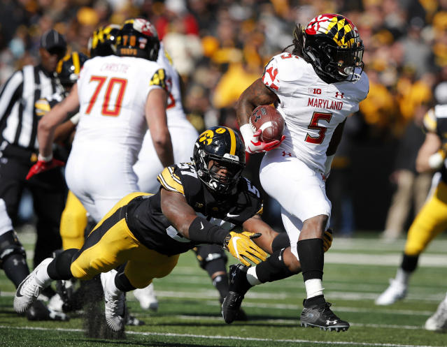 FILE - In this Saturday, Oct. 20, 2018, file photo, Maryland running back Anthony McFarland (5) is tackled by Iowa defensive end Chauncey Golston (57) during the second half of an NCAA college football game, in Iowa City, Iowa. McFarland started only five games as a freshman, yet still managed to top the 1,000-yard mark. He raised eyebrows around the Big Ten after running for 298 yards against Ohio State. Now hes poised to become one of the leagues dominant backs. (AP Photo/Charlie Neibergall, File)