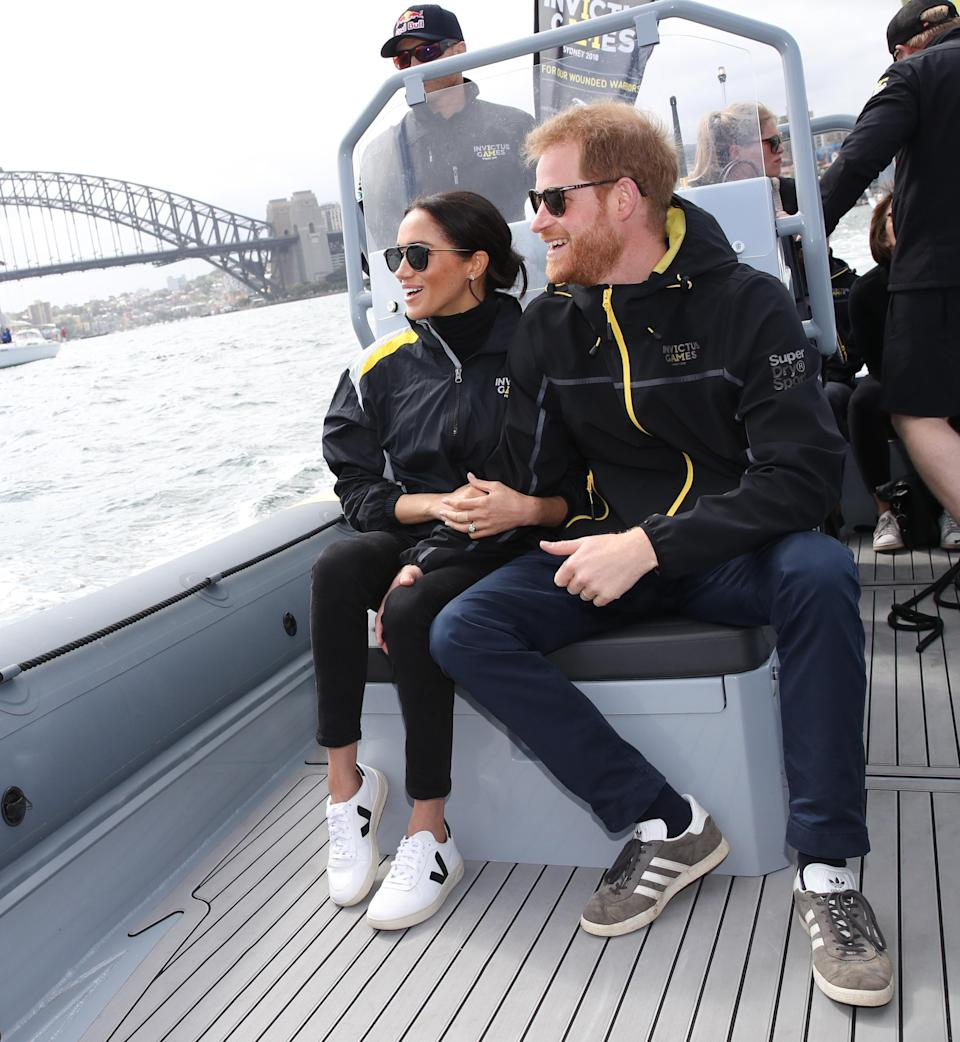 <p>Wearing this year's £114 'It' trainers (by sustainable label Veja) and an athletic get-up by SuperdrySport, Meghan showcased her sporty side for the first time. <em>[Photo: Getty]</em> </p>