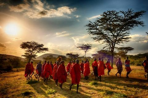 Maasai tribesmen in red robes - Credit: getty