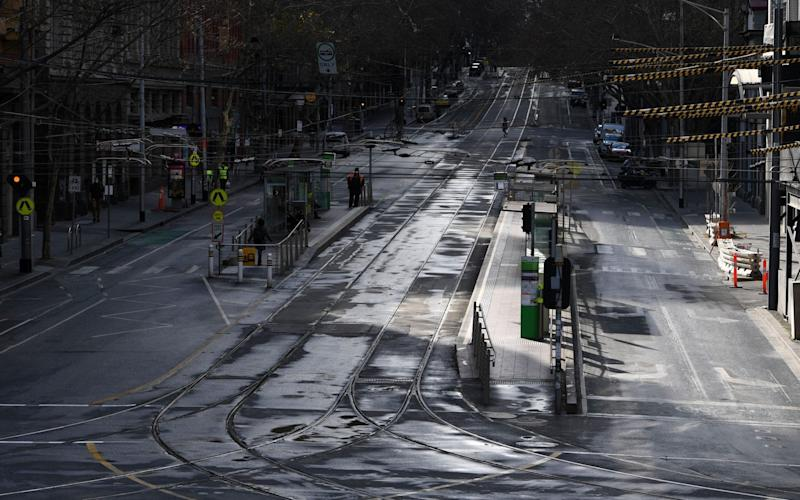 Empty Bourke Street in Melbourne as stage four coronavirus restrictions are in force including a 8pm to 5am curfew - JAMES ROSS/EPA-EFE/Shutterstock