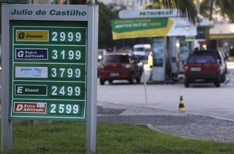 The prices of gasoline, ethanol and diesel fuel are shown at a gas station at Copacabana Beach in Rio de Janeiro