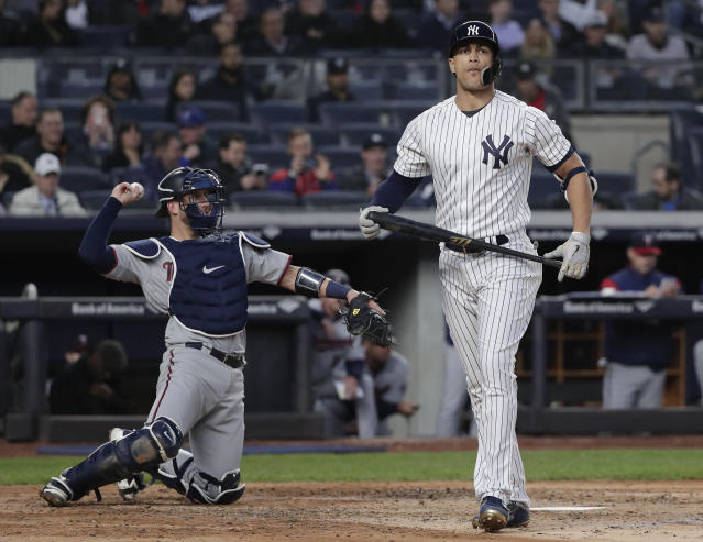New York Yankees designated hitter Giancarlo Stanton reacts after striking out swinging against the Minnesota Twins during the third inning of a baseball gam Tuesday, April 24, 2018, in New York. (AP Photo/Julie Jacobson)