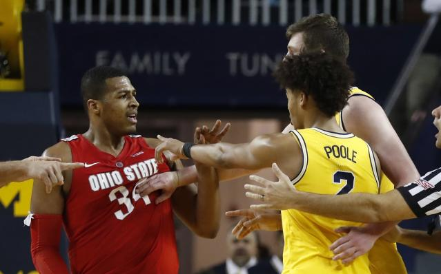 Michigan center Jon Teske pushes away Ohio State forward Kale Wesson while guard Jordan Poole (2) gestures during the second half of an NCAA college basketball game Tuesday, Jan. 29, 2019, in Ann Arbor, Mich. (AP Photo/Carlos Osorio)