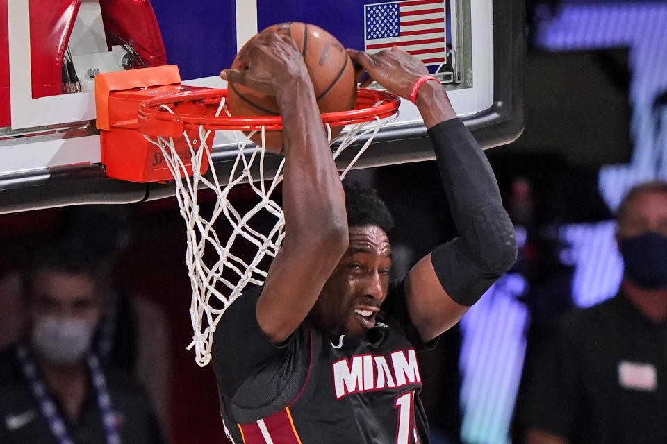 Bam Adebayo dunks with his back to the rim.