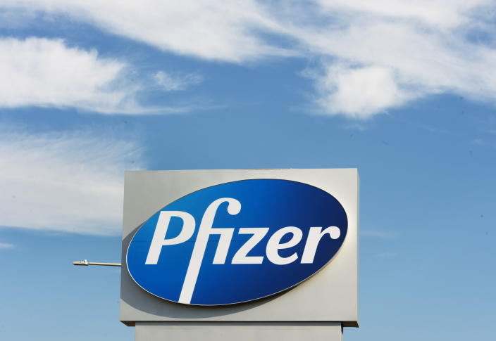 FILE - In this Monday, Nov. 9, 2020, file photo, a sign with the Pfizer logo stands outside the corporate headquarters of Pfizer Canada in Montreal. Pfizer announced Wednesday, Nov. 18, 2020, more results in its ongoing coronavirus vaccine study that suggest the shots are 95% effective a month after the first dose. (Ryan Remiorz/The Canadian Press via AP, File)