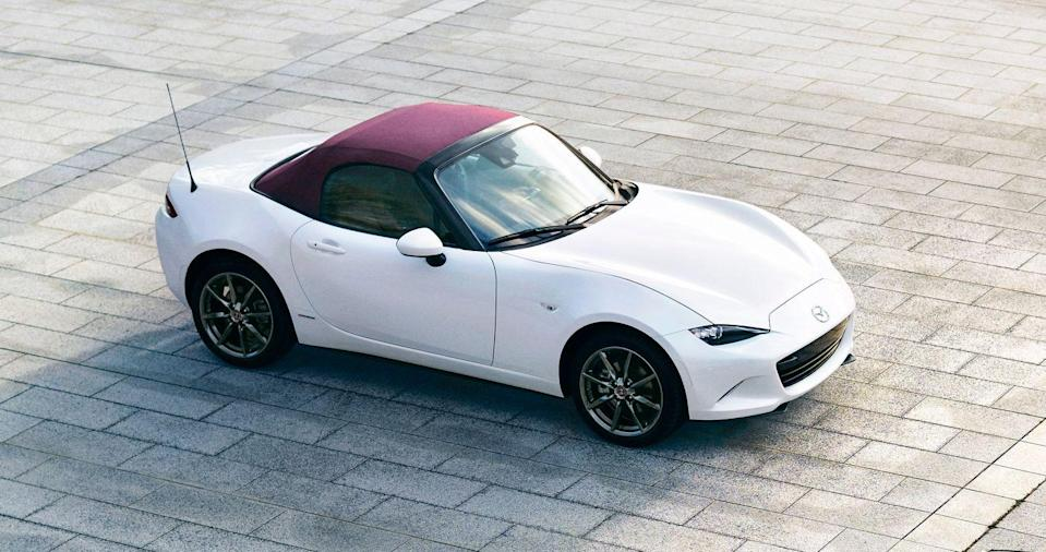 "<p>Calling the <a href=""https://www.caranddriver.com/mazda/mx-5-miata"" rel=""nofollow noopener"" target=""_blank"" data-ylk=""slk:2021 Mazda MX-5 Miata"" class=""link rapid-noclick-resp"">2021 Mazda MX-5 Miata</a> an automotive icon is no overstatement, as its heritage stretches back more than 30 years and its cheerful driving demeanor has always been its strongest character attribute. The Miata's four-cylinder engine delivers just enough power to make it feel spunky and its chassis is delightfully balanced—perfect for zipping through curvy sections of road. Both a soft-top convertible model and a power-folding hard-top called the RF are offered, so with either one buyers are treated to fun in the sun. The Miata's cabin is tight for two and cargo space is limited, but it wasn't made for road trips; it's designed for spirited sunny-drenched drives and track days. The fact that it remains one of the cheapest ways to get into a convertible sports car only adds to its appeal.</p><p><a class=""link rapid-noclick-resp"" href=""https://www.caranddriver.com/mazda/mx-5-miata"" rel=""nofollow noopener"" target=""_blank"" data-ylk=""slk:Review, Pricing, and Specs"">Review, Pricing, and Specs</a></p>"