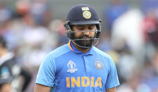 India's Rohit Sharma reacts as he leaves the field after being dismissed by New Zealand's Matt Henry during the Cricket World Cup semi-final match between India and New Zealand at Old Trafford in Manchester, England, Wednesday, July 10, 2019. (AP Photo/Aijaz Rahi)