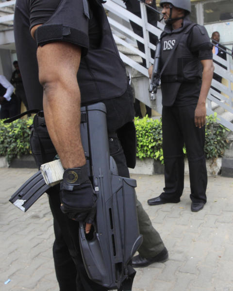 In this photo taken, Monday, Jan. 30, 2012. Nigeria secret service officers stand guards during a court hearing in Lagos, Nigeria. The Associated Press has learned on Thursday, Aug. 30, 2012, that personnel records of former and current members of Nigeria's top domestic spy agency, including home addresses and names of immediate family members, were leaked onto the Internet. The data about more than 60 employees of Nigeria's State Security Service remained easily accessible on the Internet for days. It also had details about the agency's director-general, including his mobile phone number, bank account details and contact information for his son. (AP Photo/Sunday Alamba)
