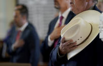 Texas State Rep. Cecil Bell, Jr., R-Magnolia, holds his hat to his chest as he joins in the pledge in the House Chamber at the Texas Capitol as they prepare to debate voting bill SB1, Thursday, Aug. 26, 2021, in Austin, Texas. (AP Photo/Eric Gay)