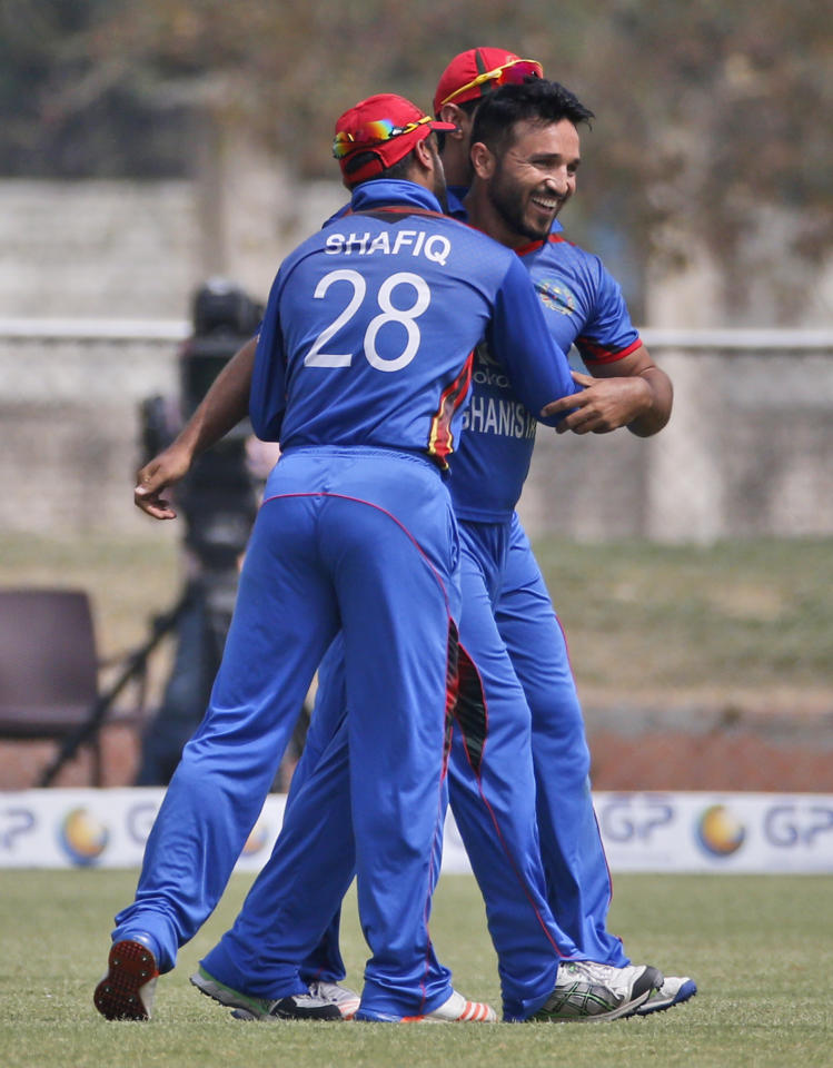 <p>Afghanistan's Gulbadin Naib, center, celebrates with teammates after dismissing Ireland's Paul Stirling during their fifth one day international cricket match in Greater Noida, India, Friday, March 24, 2017. (AP Photo/Altaf Qadri) </p>