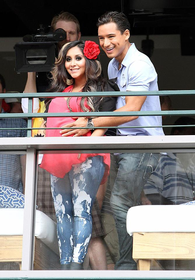 """Also at The Grove, """"Extra"""" host Mario Lopez verified for himself that """"Jersey Shore"""" star Nicole """"Snooki"""" Polizzi is indeed pregnant. (7/18/2012)"""