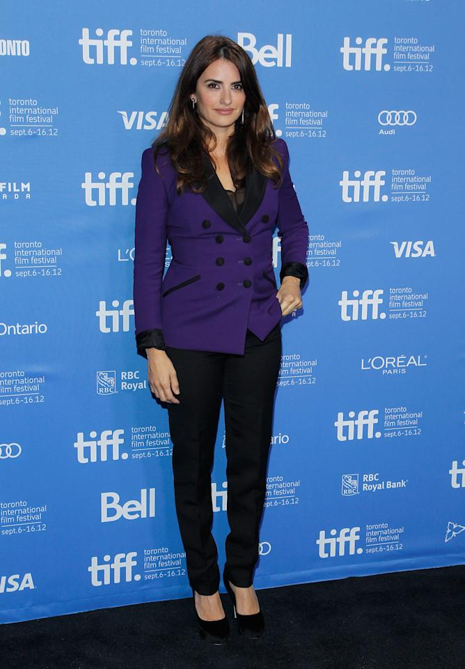 "BEST: At the ""Twice Born"" press conference earlier in the day, Cruz went a little more demure -- but she still looked incredible in this black and purple double-breasted blazer. We want it for our wardrobe!"