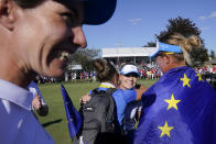 Europe's Matilda Castren, center, celebrates after her win on the 18th hole agains United States' Lizette Salas during the singles matches at the Solheim Cup golf tournament, Monday, Sept. 6, 2021, in Toledo, Ohio. Europe retains the Solheim cup. (AP Photo/Carlos Osorio)