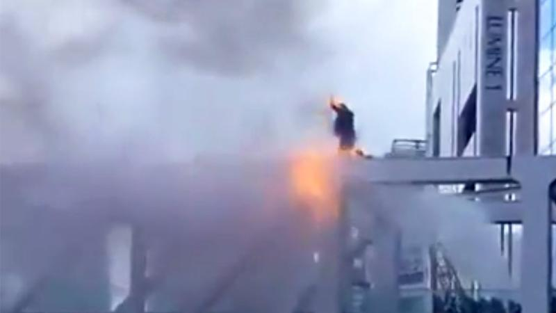 Man sets himself on fire in astonishing political protest