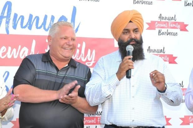 Premier Ford and Jagdish Grewal are pictured together at a Grewal annual family barbecue in 2019.